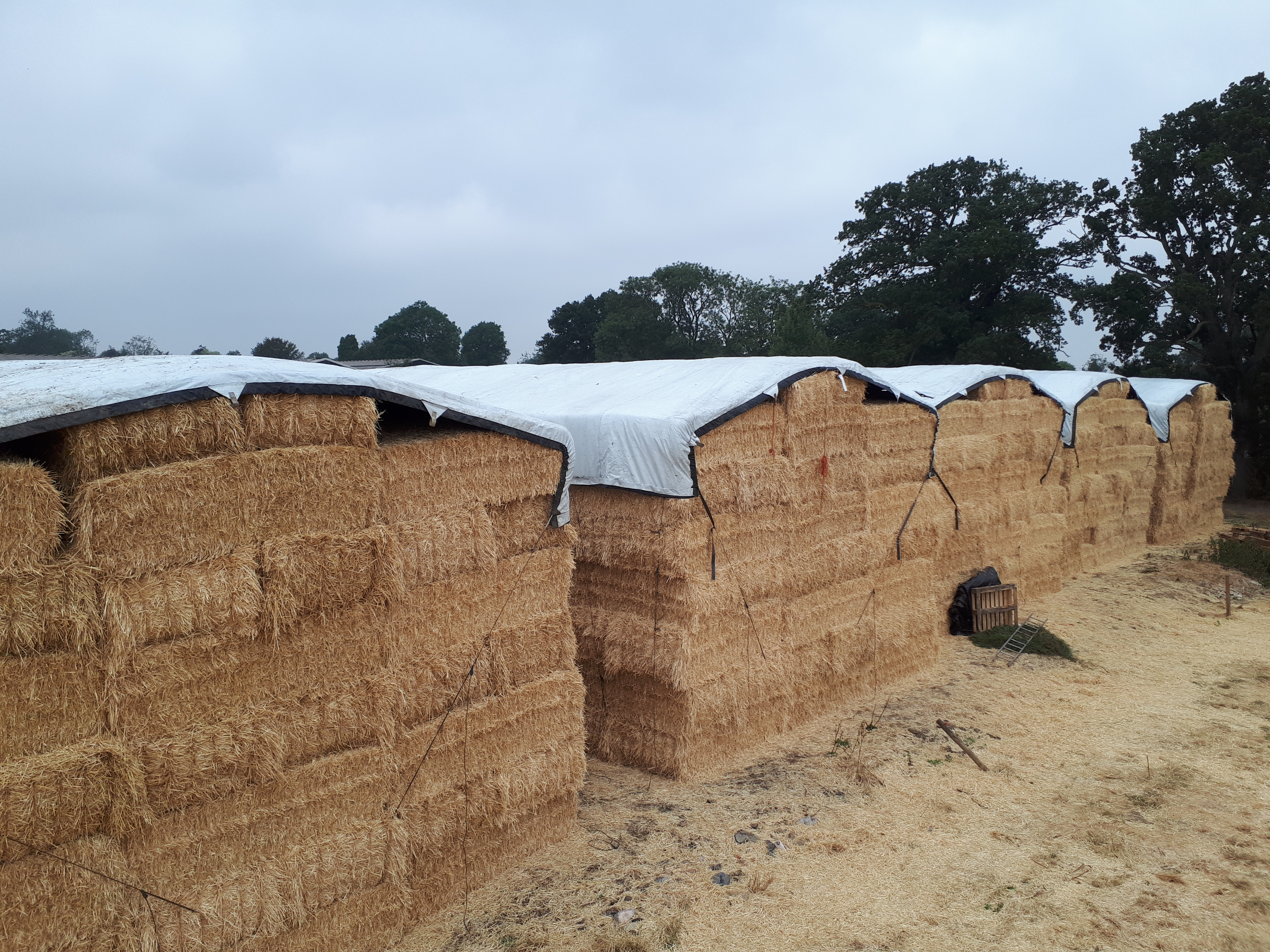 Square Straw stack with  performer Tarpaulins